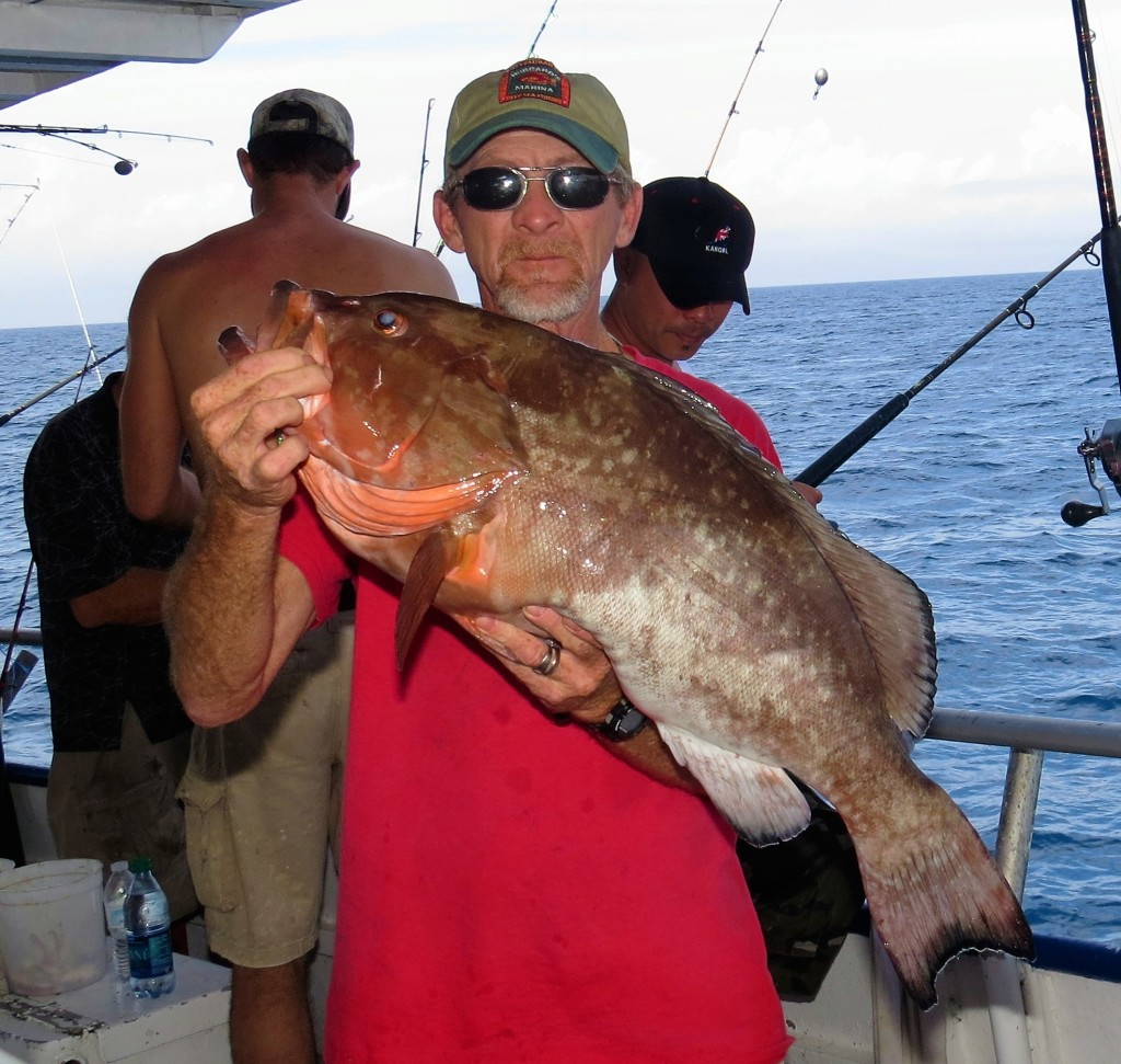 Captain Bryon Holland showing off a big red grouper