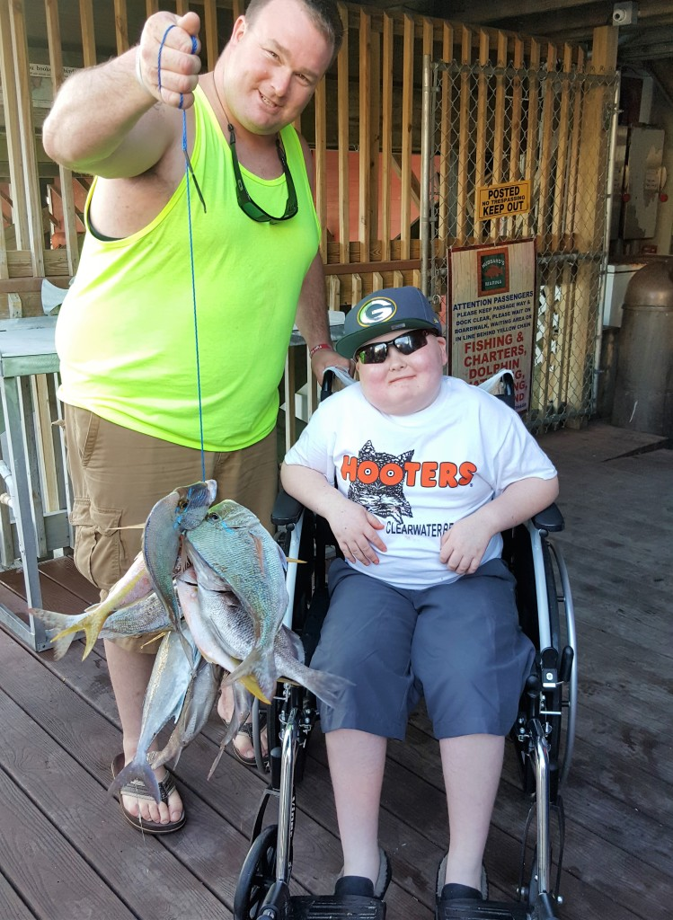 Left-Right- Jesse Johnson and his son Ryan Johnson from Wisconsin showing off Ryan's catch from his Make a Wish foundation trip with Hubbard's Marina