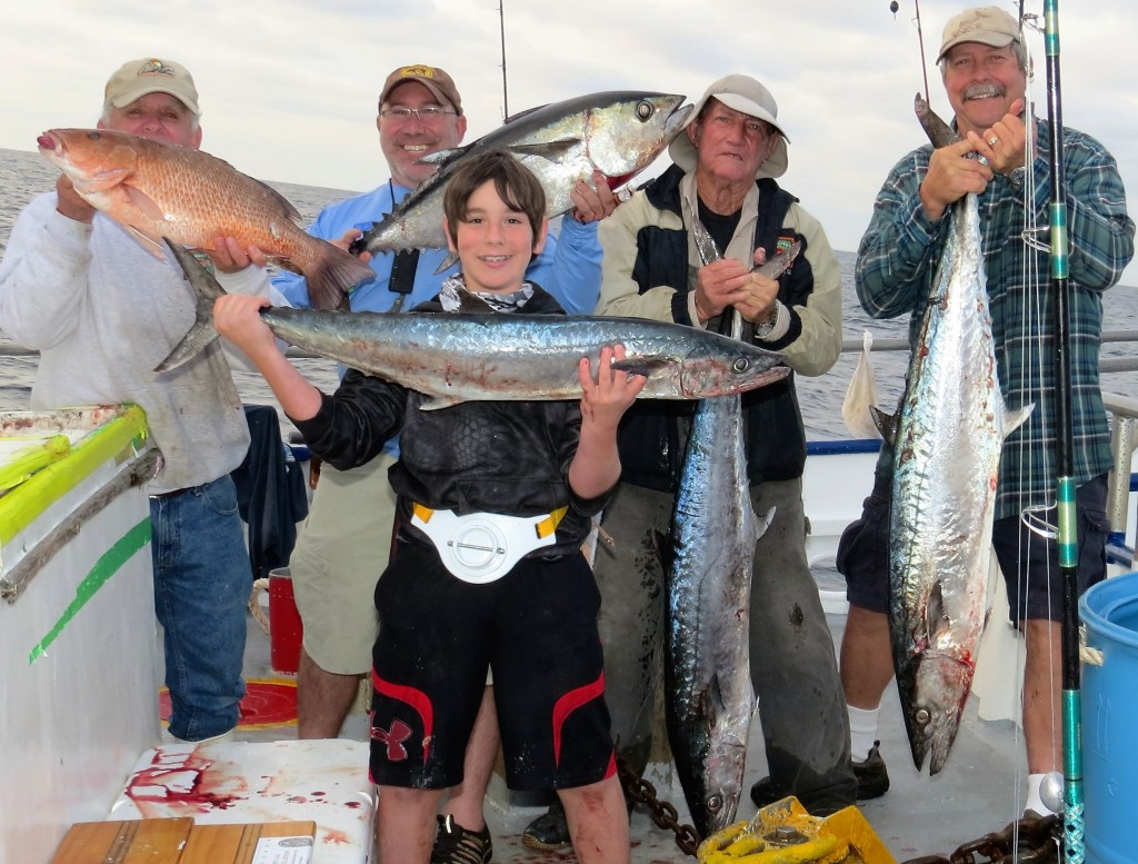 Left-Right- Larry Miller, Eric Geller, Eric's son Max Geller, Jig head ed sumrall, and ed's cousin Dan Jackman - all showing off mangrove snapper, tuna and kingfish from our 39 hour
