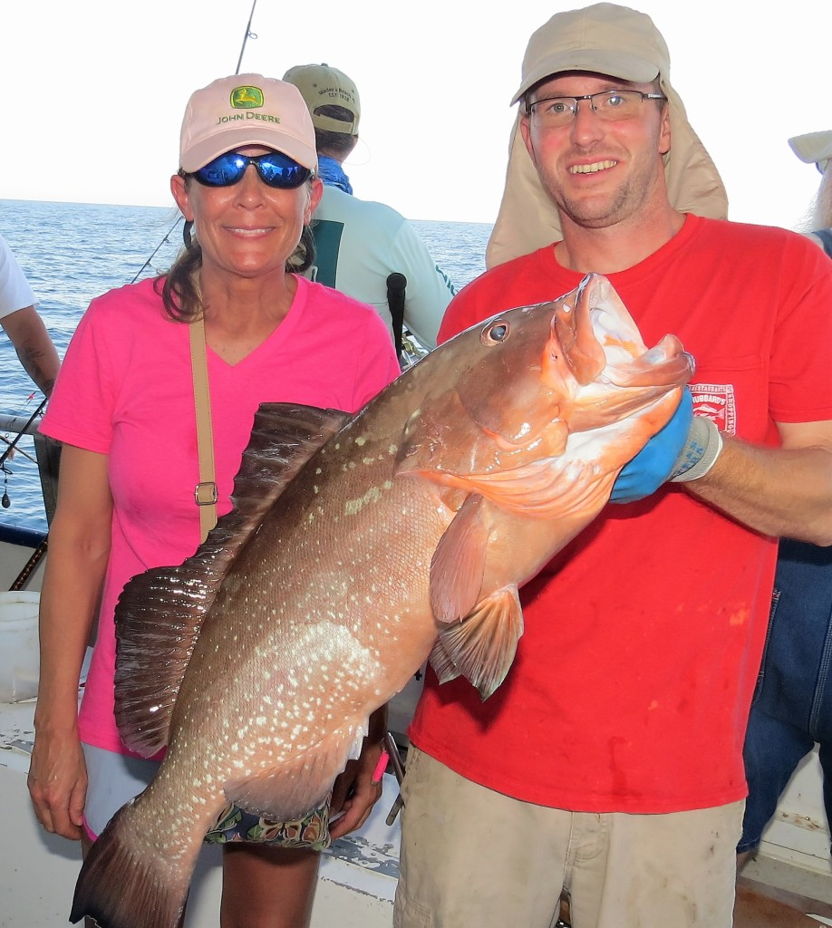 Left-Right - Michelle Godwin from Georgia showing off her 17lb Red grouper and first mate Will McClure from the 39 hour at Hubbard's Marina