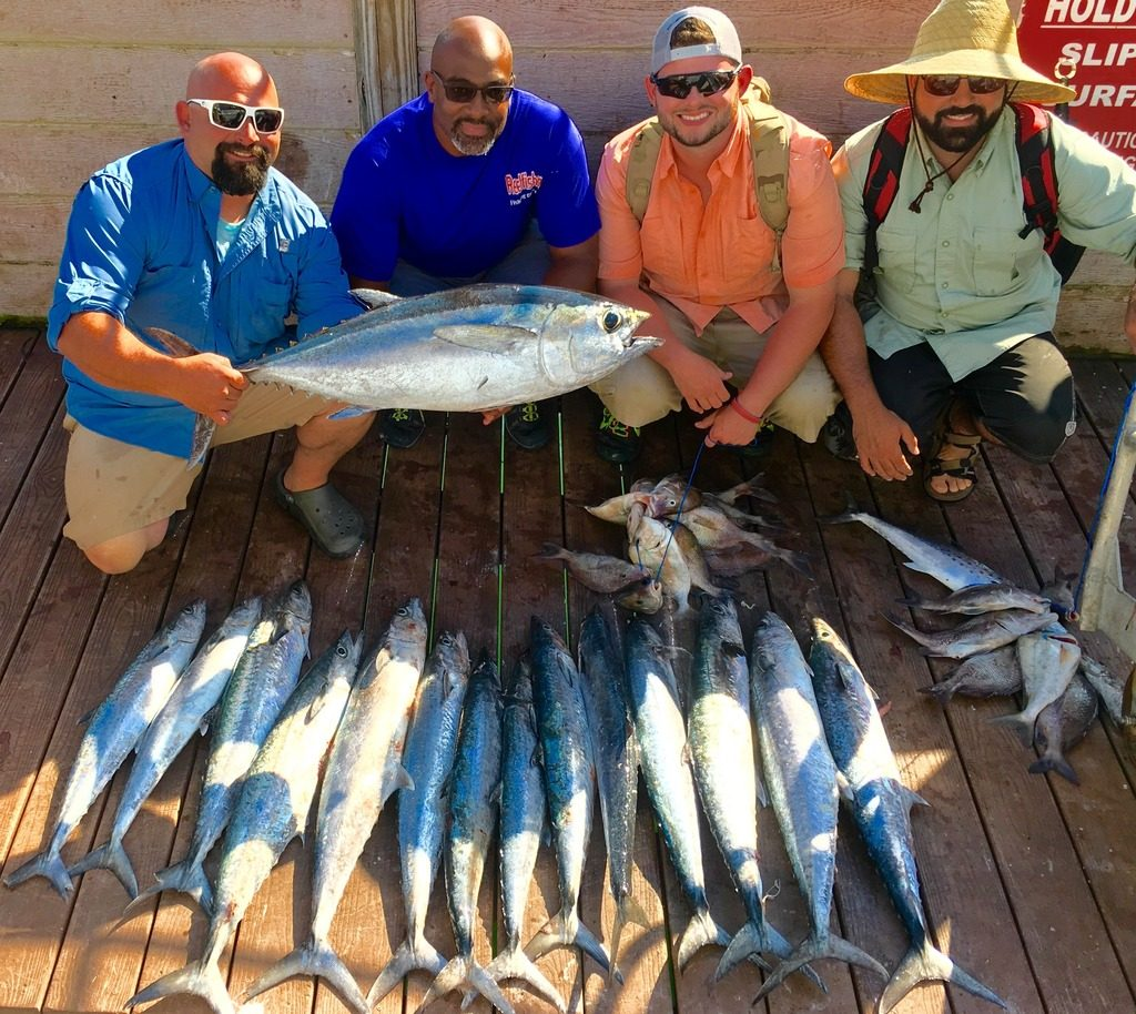 Left-Right-Captain Frank, Allen Miller, Patrick Venegas,Frederick Carvalho showing off kingfish and tuna caught on a 10 hour all day fishing trip at Hubbard's Marina